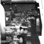 Groups of Workers Seen From Above Inside Factory Working With Wood and Lifting Into Piles
