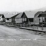 Fruit Growers Supply Cottages Located in Susanville, California Made of Log