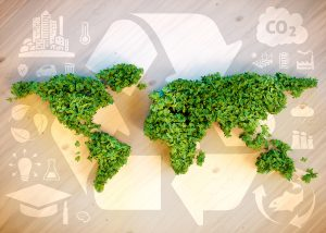 Recycle Logo With Continents in Foreground Made of Leaves