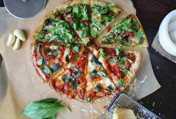 Basil-topped pizza appearing in healthy restaurant menus.